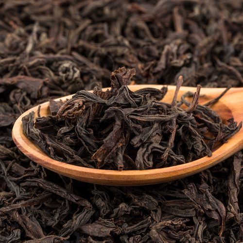 loose leaf tea with wooden spoon